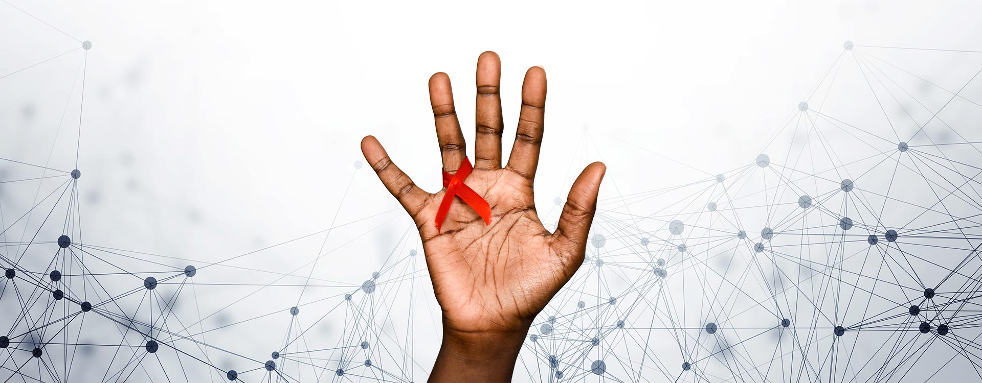 African hand with a red ribbon to represent Aids
